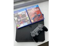 PlayStation 4 & two games for sale