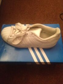 2 pair girls trainers and leather jacket good condition