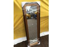 full length ribbed gold framed mirror