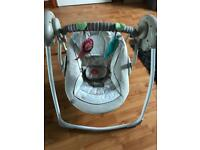 Baby swinging seat with lullabies