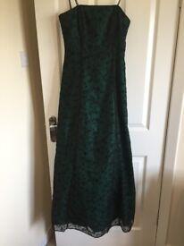 Full length Strapless green ball dress with black flower detailing. Size 10