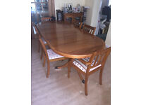 Extending Twin Pedestal Dining Table in Yew finish with six Chairs.