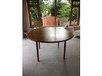 Oval shaped solid wood dining table