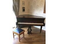 Mahogany coloured baby grand piano
