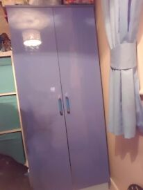Blue high gloss wardrobe, drawers and bedside cabinet