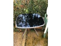 Garden table and chairs and black umbrella