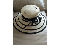 Beautiful cream and black hat with feather detail