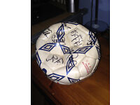 two signed swansea city footballs