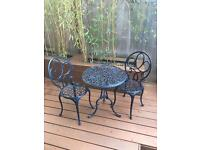 Cast iron effect green outdoor garden or patio table and chairs
