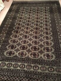 Green, red, cream and black Persian rug