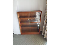 Glass fronted book shelf
