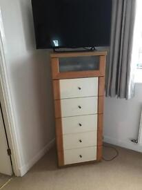Ikea tall chest of drawers.