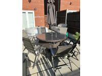 Rattan Patio table, 6 chairs and parasol