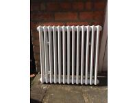Double column radiator and wall brackets