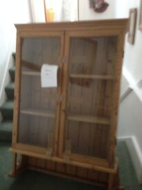 pine bookcase with glass cabinet with ornate carving