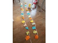 Colourful, fun elephant design bunting perfect for baby nursery. Bold colours and patterns