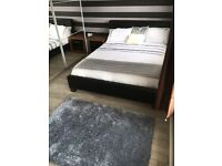 Black Faux leather king size bed