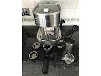 DeLonghi coffee machine with accessories