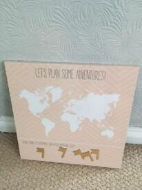 Pink world map with magnetic flags
