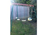 Swing set, baby swing, big swing and seesaw. Good condition.