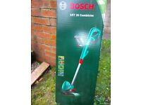 BOSCH ART COMBITRIM GARDEN EDGE TRIMMER, A GARDENER'S MATE TREE LOPPER, A RAKE, A HOE AND A SPADE