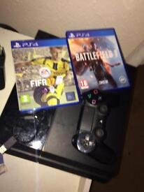 PlayStation 4 with battlefield 1 and Fifa 17.