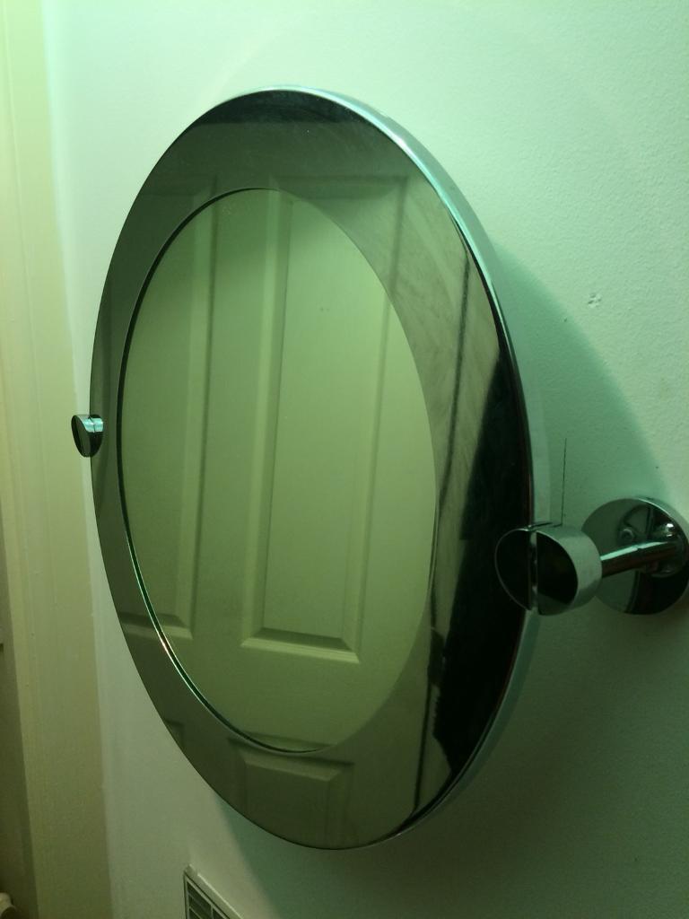 Next circular wall mounted bathroom mirror