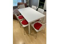 WHITE DINING TABLE AND 8 CHAIRS