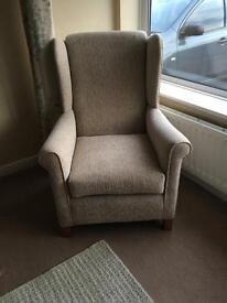 Wingback chair in light beige