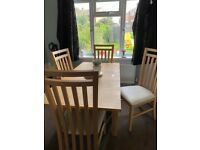 Solid oak extendable dining table chairs not included