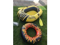 INFLATABLE BOAT FOR THE KIDS ON HOLIDAY WITH OARS WITH RING