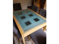 Glass dining table extending