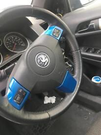 Steering wheel bits in blue for Vauxhall Astra