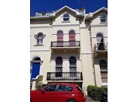 Spacious 2 bedroom regency garden flat with garden and parking