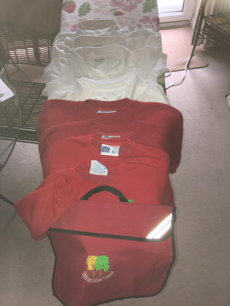 Sylvan infant school sweatshirts (4) polo shirts (6) book bag (1). Range 6 to 8 in age. 07860629420.