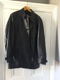 Man's Gap black leather jacket with quilted lining.