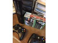 Xbox 360 E 250gb with 4 games and 2 controllers