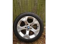 Set of four BMW alloys with new tyres.