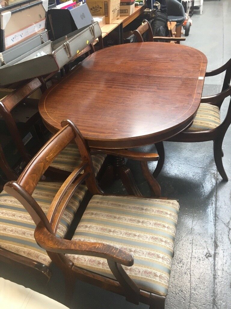 Extendable table and seven chairs