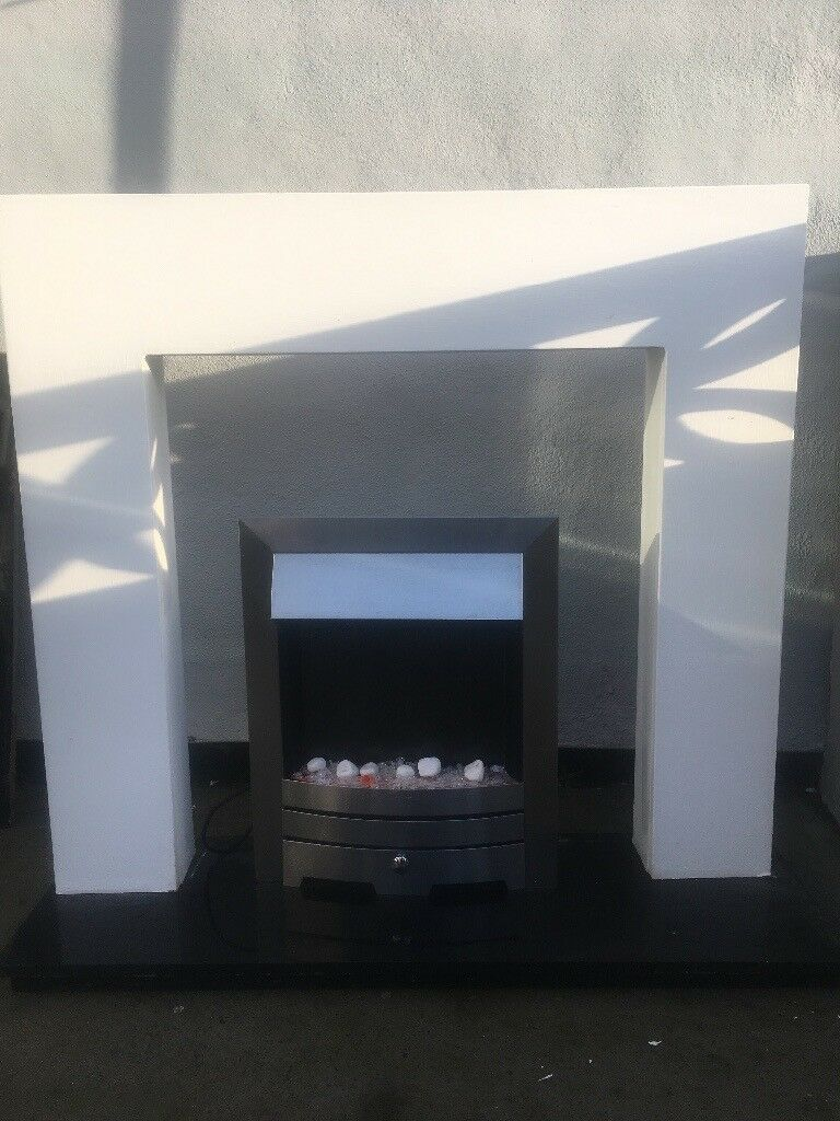 Electric fire complete with surround and hearth