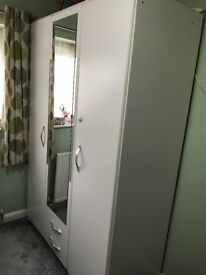 White 3 Door 2 Drawer mirrored wardrobe.