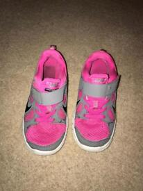 Pink and grey Nike free run trainers size 11