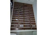 Double wooden bed in usable condition.