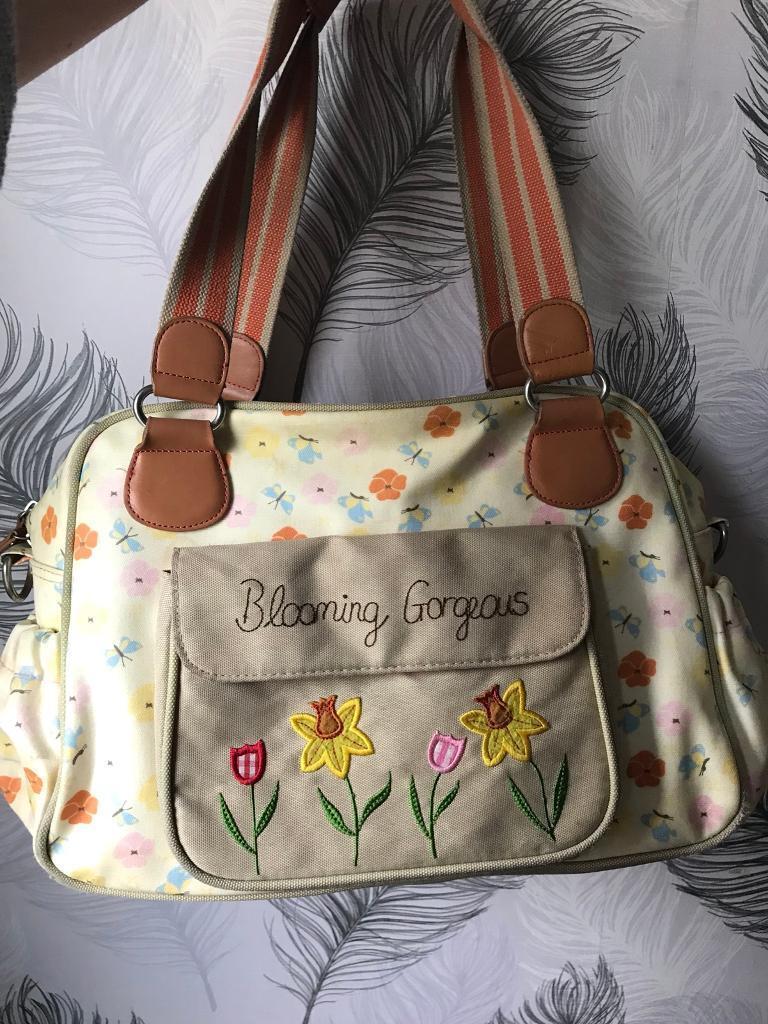 """Pink lining """"blooming gorgeous"""" changing bag"""