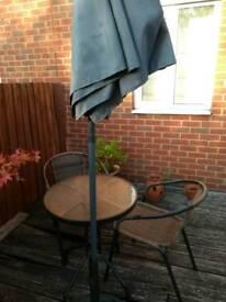 Bistro set and parasol