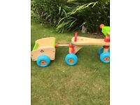 Elc wooden toddler trike and trailer.