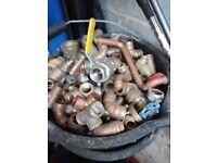 Bucket of various copper fittings plumbing