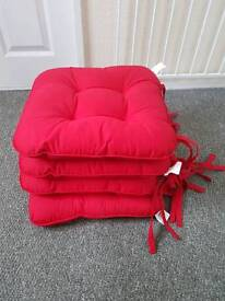 Bright red cushioned chair covers