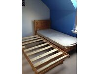 Solid Single Pine Bed with integrated additional single bed..Very useful
