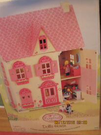 Rosebud Village Dolls House. With furniture and dolls included.